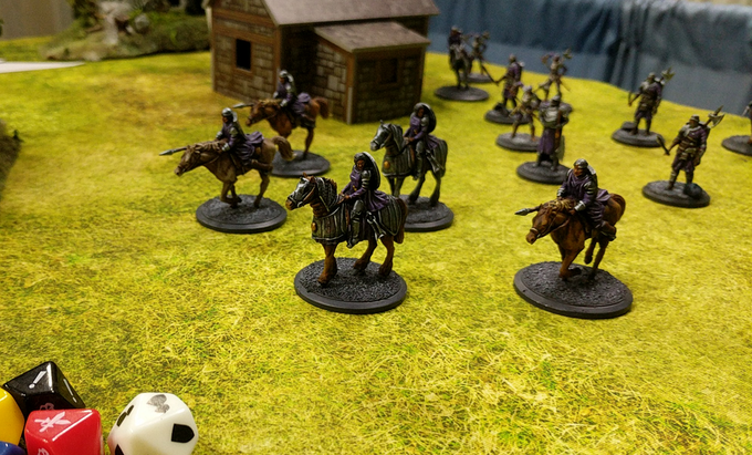 The forces of Arkland rally behind a Paladin as she leads them into battle.