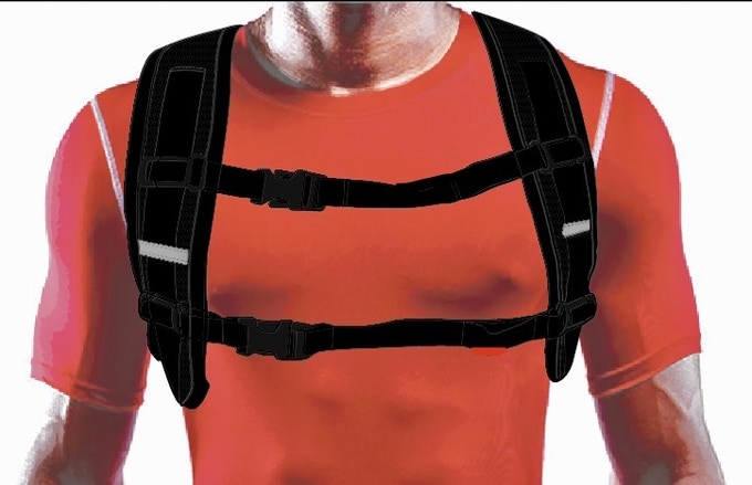 The sternum straps are the key to a snug fit, thus centralizing the cargo's mass to your body. They adjust vertically & horizontally, and are removable altogether.  The safety reflectors will be repositioned on the newer version.