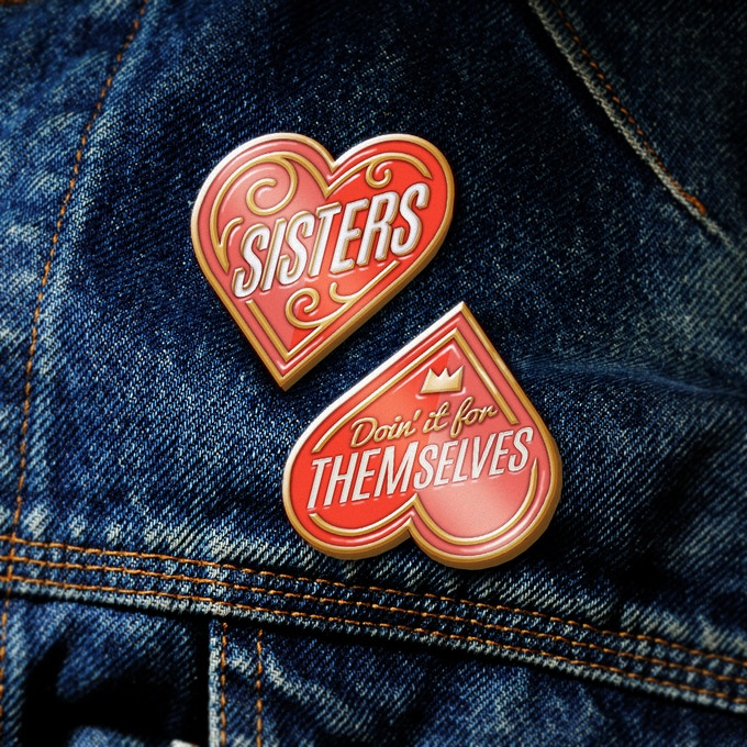 1 set of (2) Sisters enamel pins, designed by Elizabeth Perez (image is artist rendering)