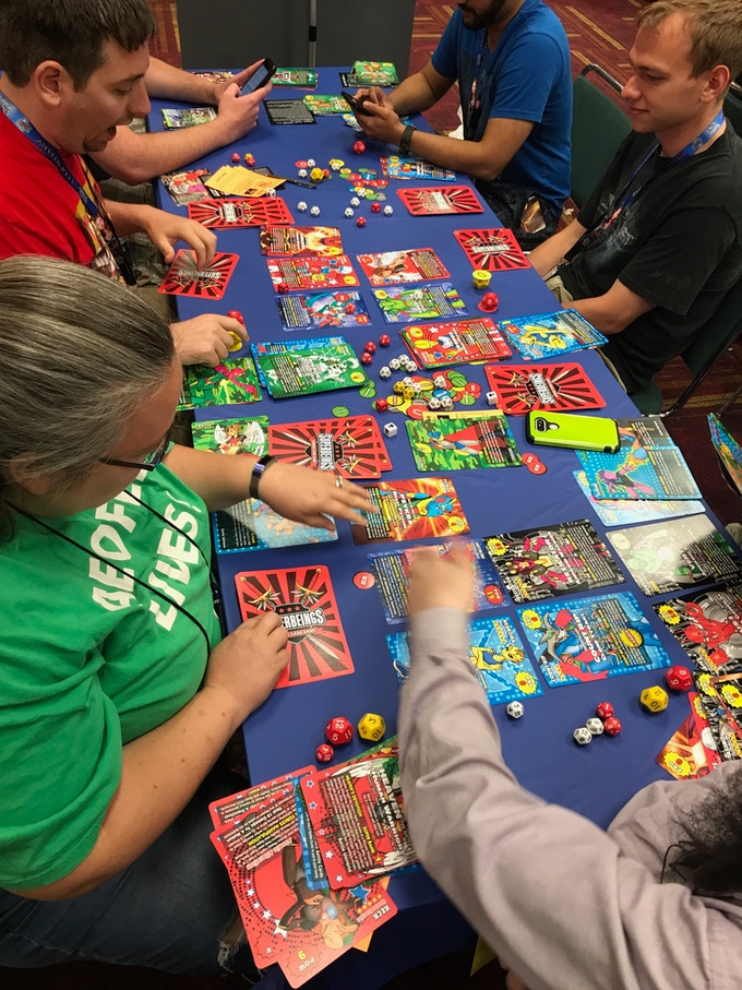 Superbeings Jumbo Card Game in the Playtest Hall at Gencon50