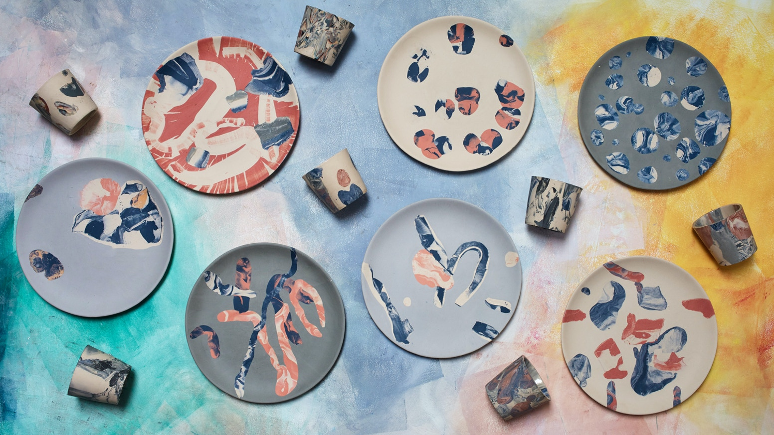 Colourful plates & cups made by squishing clay in a hydraulic press. Handmade in Liverpool. Each one is unique.