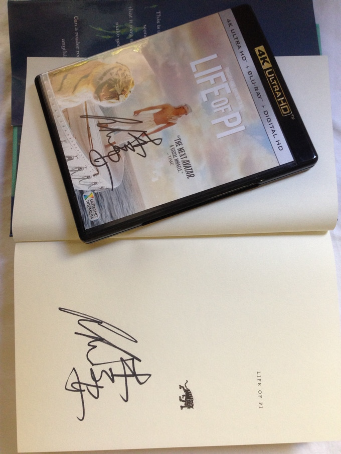 "A soft cover book AND the Ultra HD 4k DVD of ""Life of Pi"" -- BOTH signed by Ang Lee."