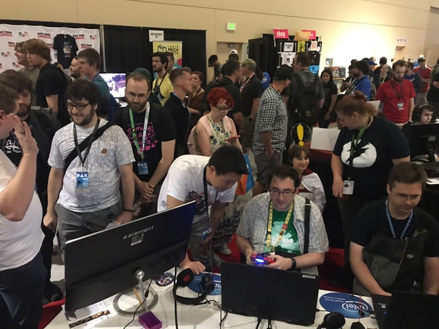 Our booth was packed like this EVERY DAY. We had to draw lines on the floor so people can wait in line to play. Thanks to Intel for the laptops and gears!