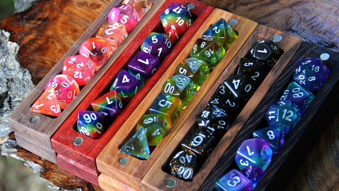 From left to right: Walnut with Maui Dice, Padauk with Rainbow Dice, Canarywood with Pegasus Dice. Chechen with Galaxy Dice, Wenge with Unicorn Dice.