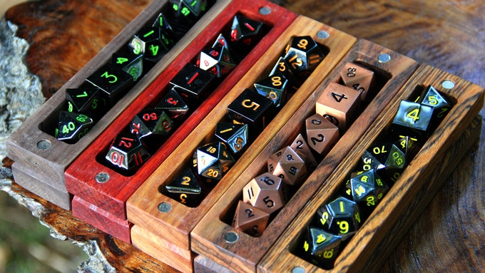 From left to right: Walnut with Onyx Green dice, Padauk with Onyx Red dice, Canarywood with Onyx Orange dice, Chechen with Burnished Copper dice, Bocote with Onyx Yellow dice.