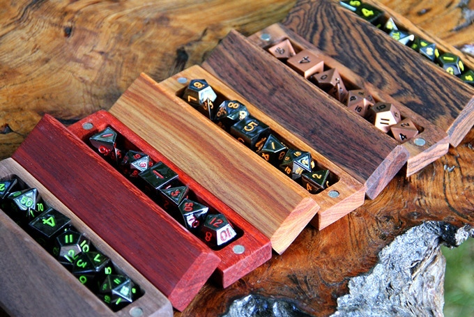 From left to right: Walnut with Onyx Green dice, Padauk with Onyx Red dice, Canarywood with Lumberjack Tears dice, Chechen with Burnished Copper dice, Bocote with Onyx Yellow dice.