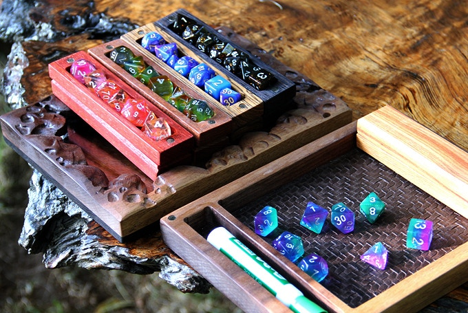 Skull Bone Box with Padauk Hero Sleeve and Maui Dice, Lepardwood Hero Sleeve and Pegasus Dice, Red Oak with Opal Dice,Wenge Hero Sleeve and Galaxy Dice and Unicorn Dice within the Bone Box.