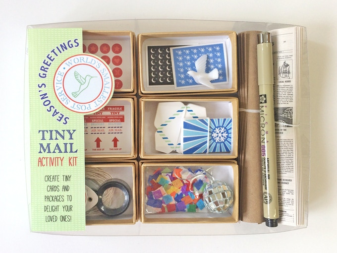 Includes little gifts: a tiny peace dove, and a disco ball and paper confetti to bring in the new year, tiny style.