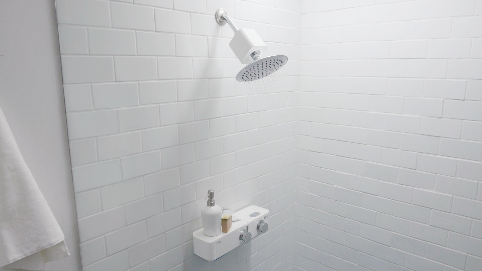 Tap a button, get a perfect shower - perfect temperature, water saving, smart integration, easy install, and sleek design.