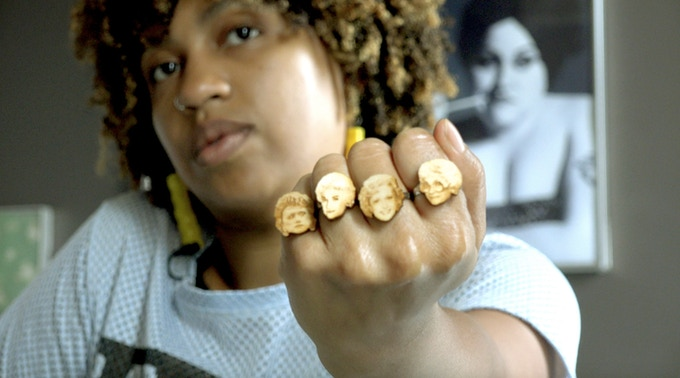 Shanthony models her Golden Girls rings in a scene from our film. Get your own ring by backing this project (check out Rewards to your right)!