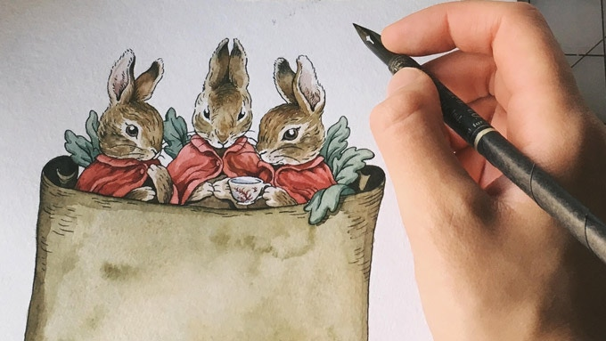 Lily Jones and her spine art for Pu'er Rabbit. Do you recognize these three bunnies?