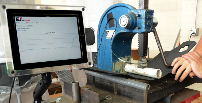 Load testing machine to ensure durability and characterize each board's flex level