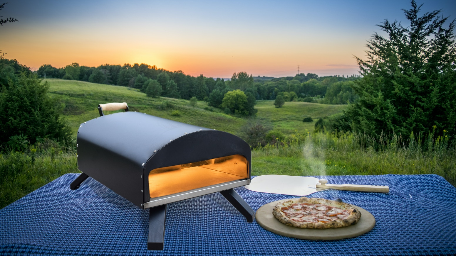 We built an outdoor oven fueled by gas, charcoal or wood. It can cook a Neapolitan style pizza at up to 900 degrees in 90 seconds.