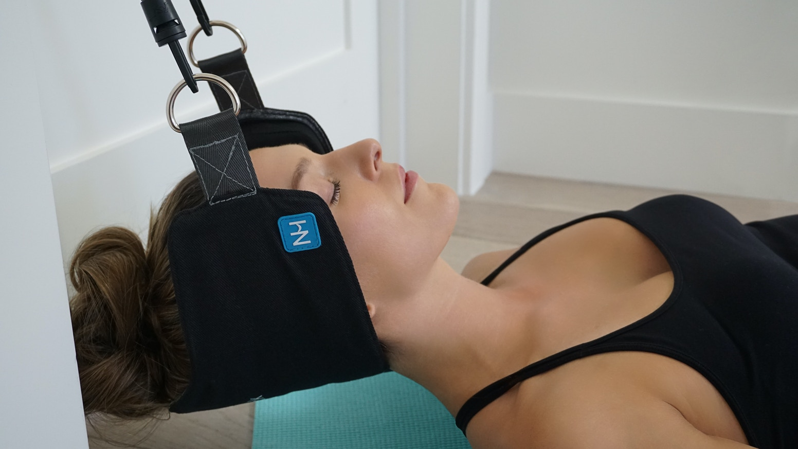 The Neck Hammock is a simple device that attaches to any door for neck pain relief in just ten minutes or less.