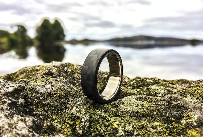 Minimalist Royalty ring with raw Titanium insert.