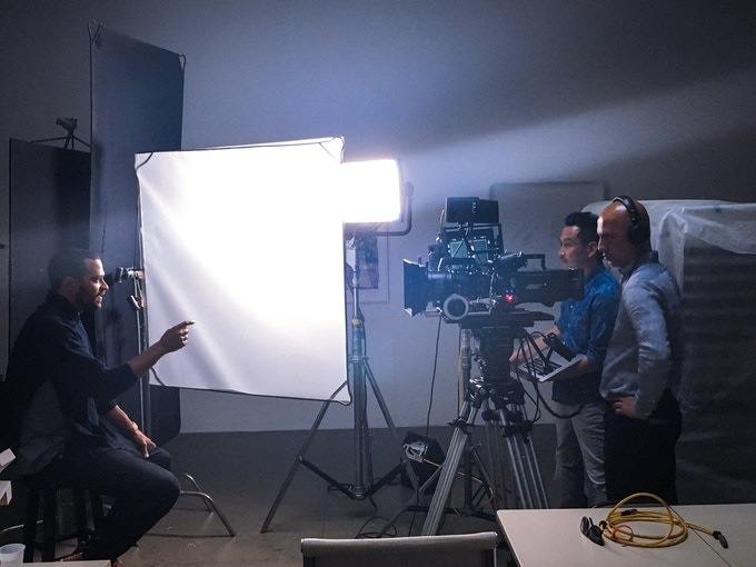 Glenn Kaino and Afshin Shahidi filming documentation of With Drawn Arms with Executive Producer Jesse Williams.