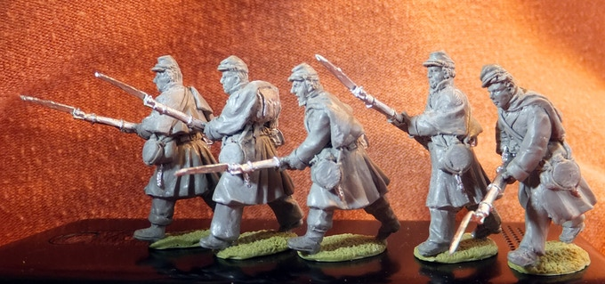 Union infantry in greatcoats attacking