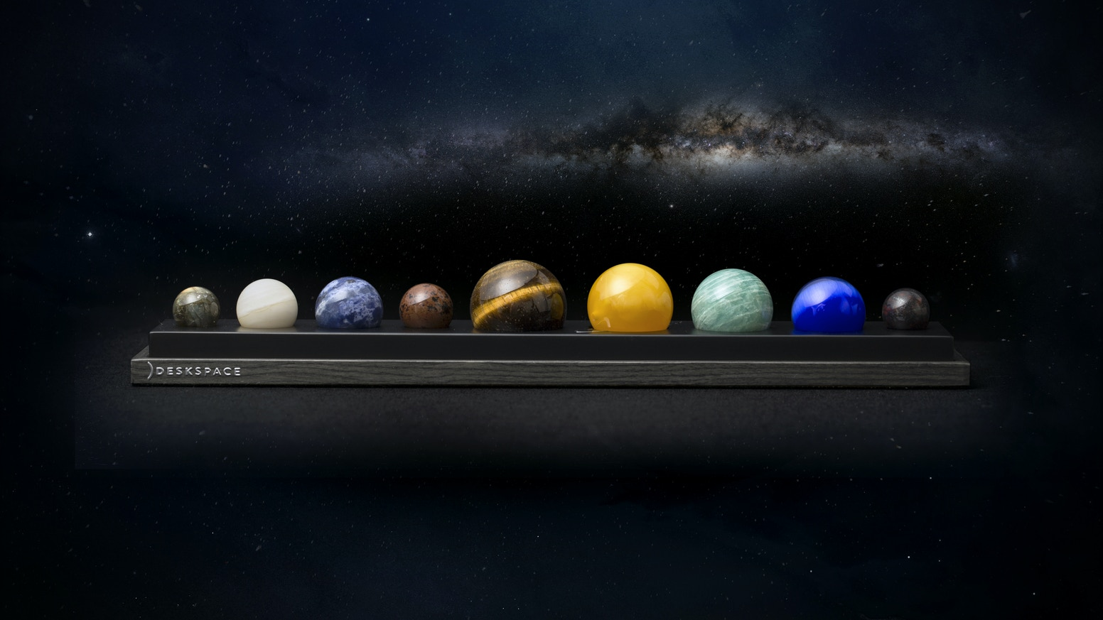 Handcrafted from nine different gems and minerals, experience the beauty of the solar system everyday from your desk.