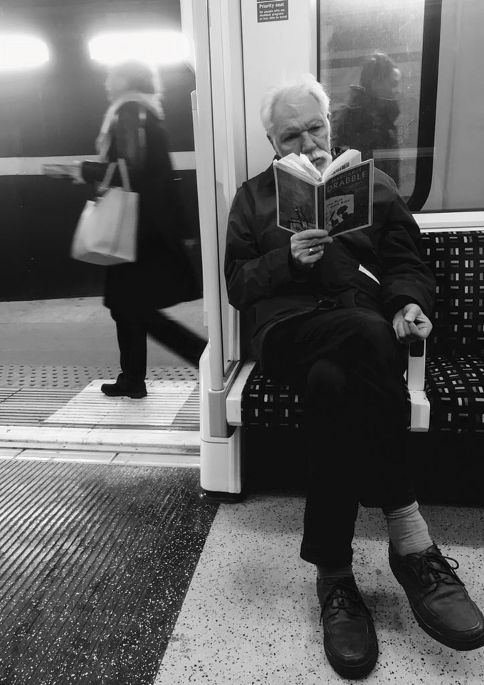 Man reads a book on the train