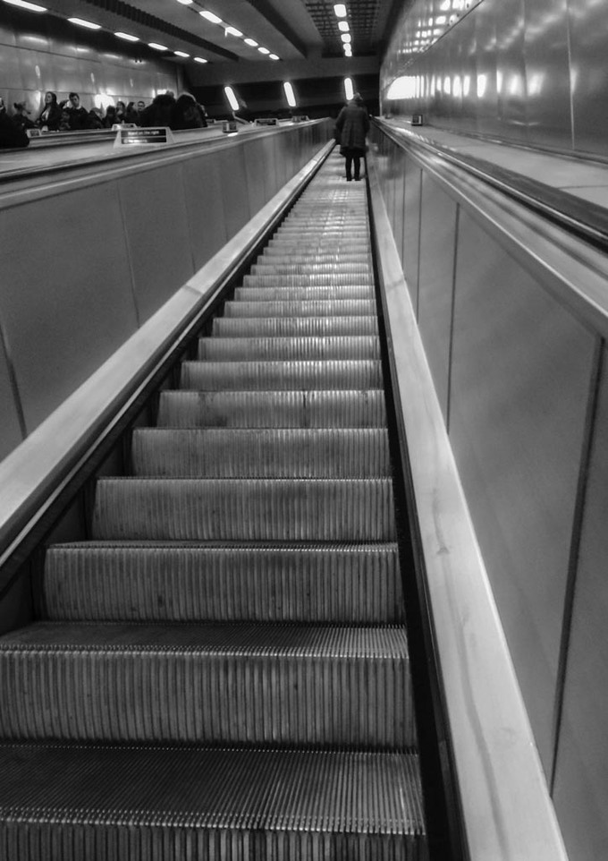 Going up on the escalator