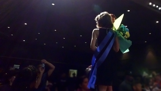 Ren on stage at the pageant