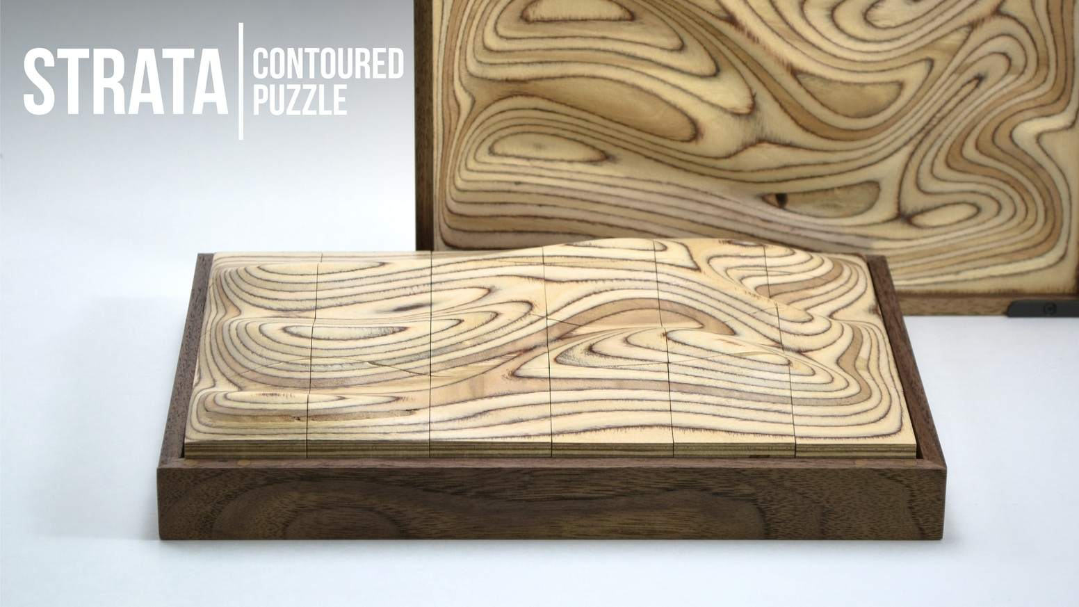 Crafted from multi-layered plywood, Strata's flowing surface blends tactile & visual cues to form a deceptively challenging puzzle.
