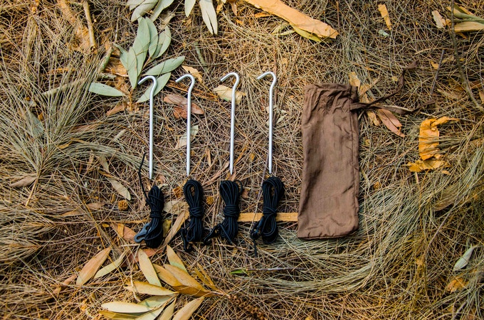 Each Hammock includes four stakes and shock cords, so you can stake out the net to create a large, tent like space inside the hammock.