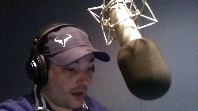 Bryan in studio, narrating an audiobook