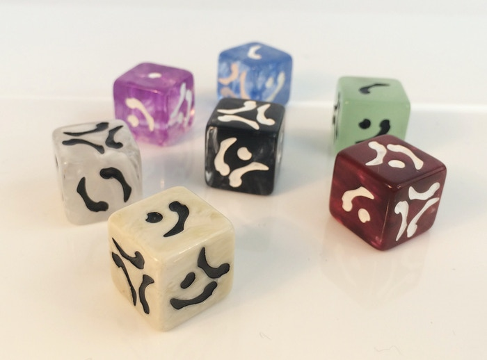 Six colors of themed dice for fantasy roleplaying and board games. With unique bone shaped markings that can be read in several ways!