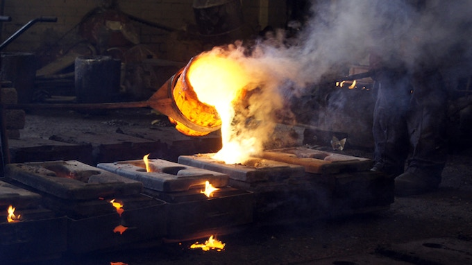 Pouring molten brass to cast buckles