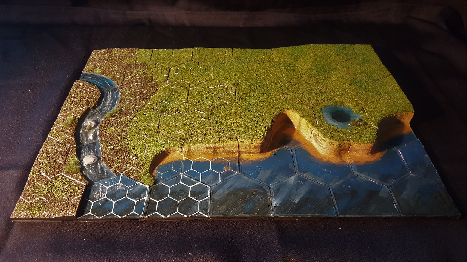 The HexT 3D printable Modular Terrain tile system, slopes, grassland, streams & rocks.