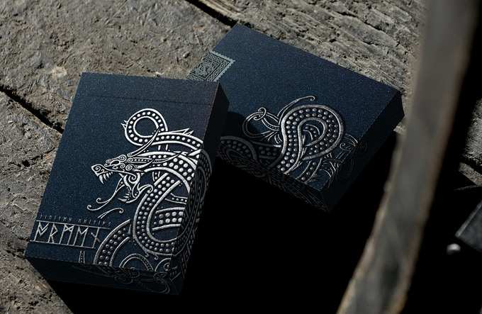 Jormungand tuck with silver foil, embossing and special stock