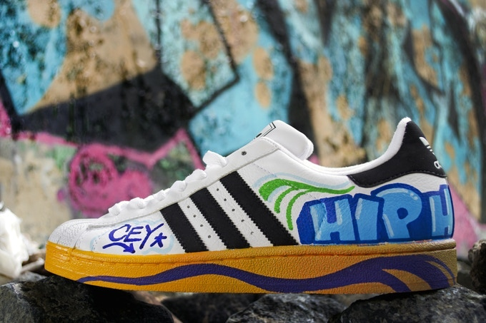 Adidas sneakers hand-painted by Cey Adams. Each pair will be a different design. Photo by Josh Weilepp.