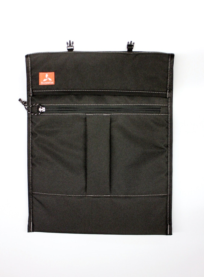 """The laptop sleeve has a pleated, zippered pocket that can accommodate even large chargers and cords. It fits laptops up to 15""""."""