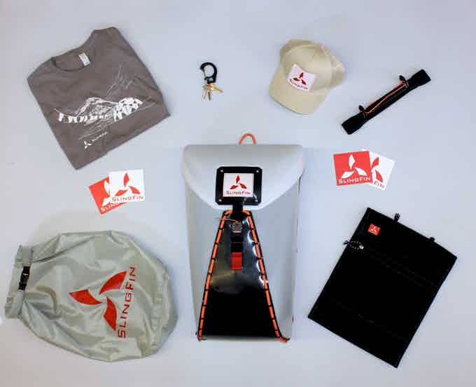 Our backer rewards clockwise from top left: SlingFin t-shirt with art by Nikki Frumkin, Cobra clip keychain, trucker hat (design and colors still in development), pannier attachment, stickers, laptop sleeve, pack, dry bag, more stickers.