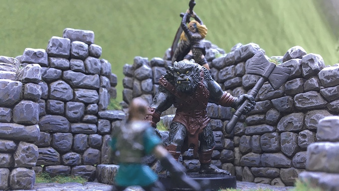 "Veera ""The Red"" slays the bugbear chief moments before he would have surely cleaved the halfling in twain"