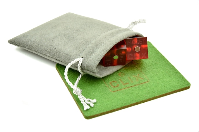 What you get with the FIDGET CLIX - Casino, including a 100% wool felt, laser cut fidget pad in a gift box.