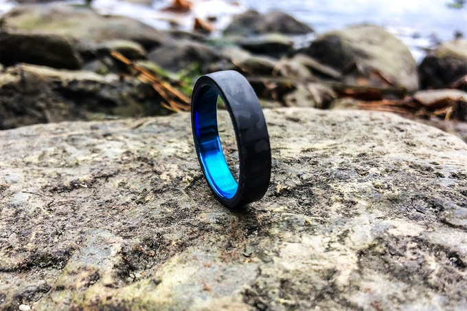 Minimalist Royalty ring with ocean blue Titanium insert.