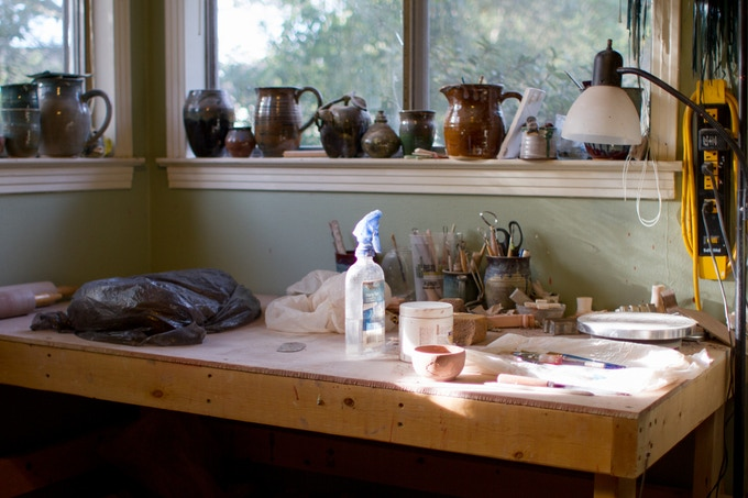 After tools, clay prep, and work in-progress, there's not much room at this work table.