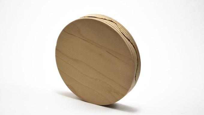 Pair of Coasters are designed to nest into one another