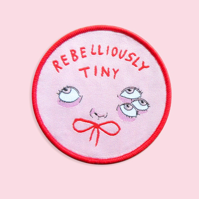 Rebelliously Tiny woven iron-on patch