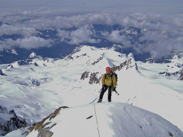 Nick Hall at the top of Mount Rainier. Photo courtesy of Philippe Wheelock.