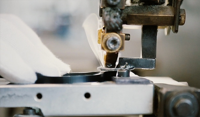 Inserting metal hinges into our acetate frames