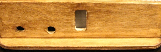The back view of the base showing USB programming port, DC jack, and water indicator window