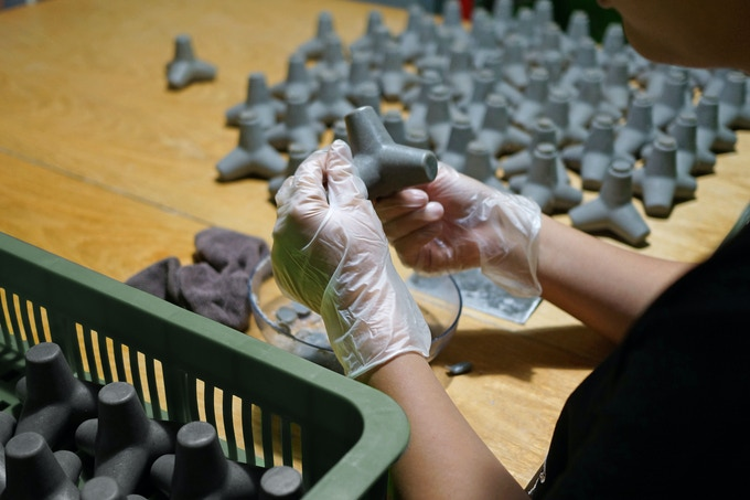 Refine by hand to remove excess bits in the molding process