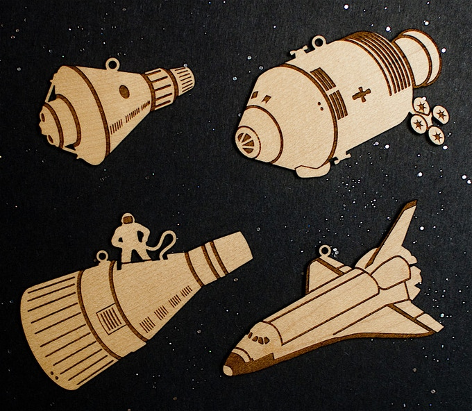 The four designs, in maple.
