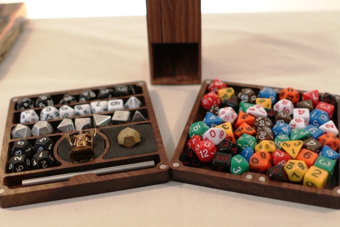 Not only do they roll perfectly on their own, they look amazing together. Shown here next to the dice that inspired them, our Silver Natural Aluminum EleMetal dice.