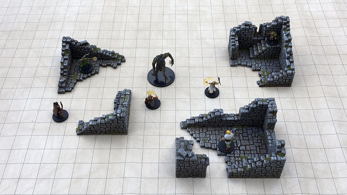 "Set 1 - ""Shacks & Guard Tower"" on a 1"" grid mat and 28mm scale miniatures."
