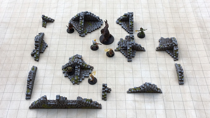 """Set 4 - """"Low Walls & Rubble"""" on a 1"""" grid mat and 28mm scale miniatures."""