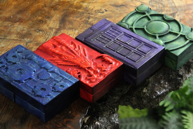 From left to right: Sapphire with Cogs Design, Crimson with Fire Dragon design, Royal Purple with Police Box Design, Kickstarter Green with Arcane Design.